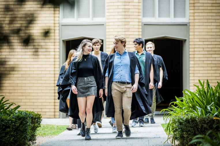 Students walking with gowns