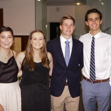 Four students formal dinner