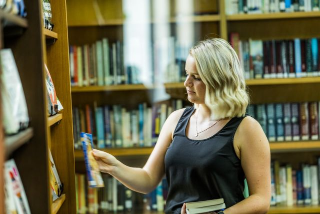 Student with books library