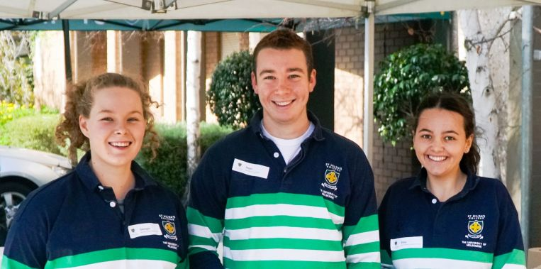 Students serving BBQ open day