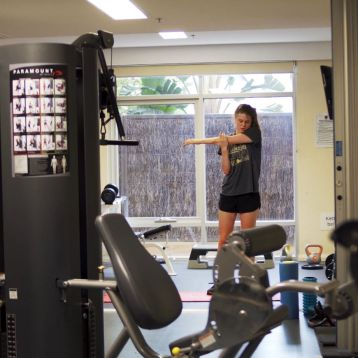 Student in the College gym