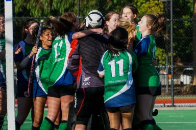 Girls hockey team after winning the grand final