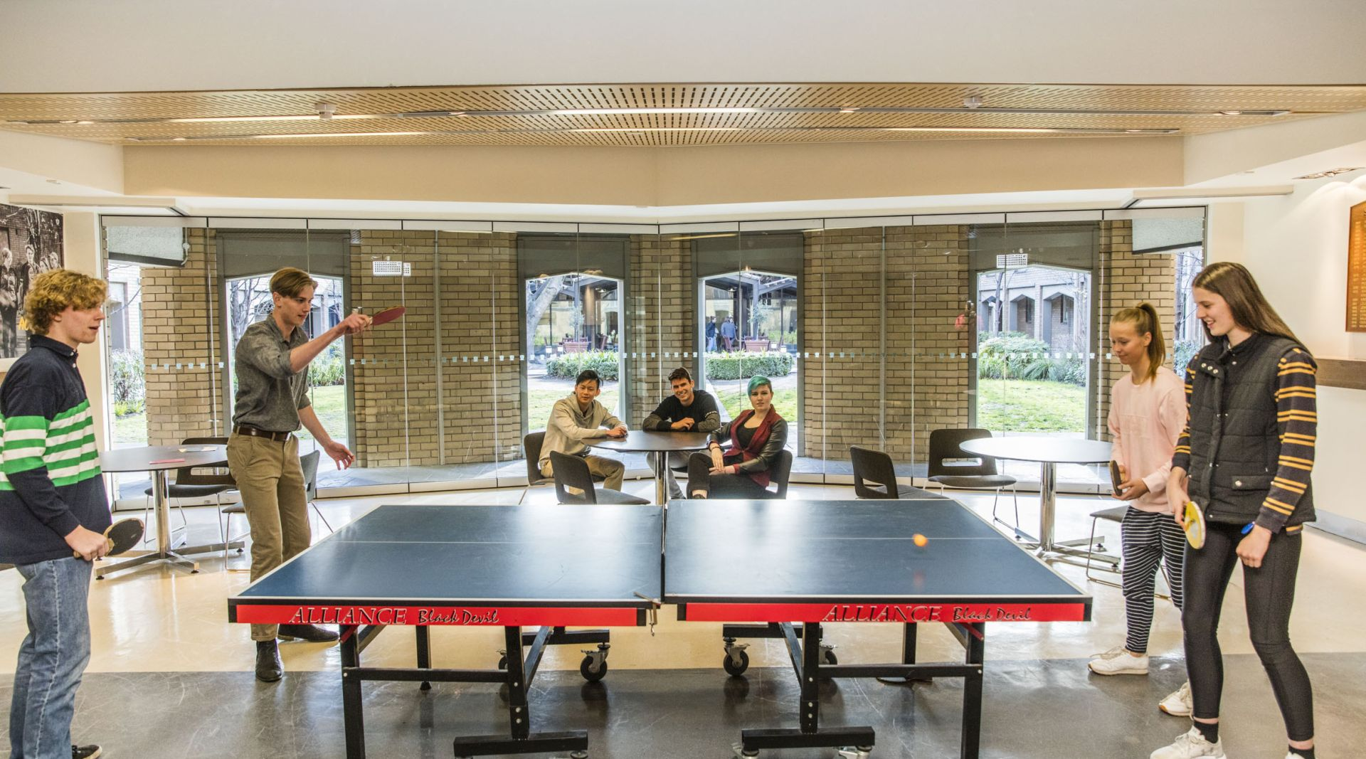 Students playing table tennis